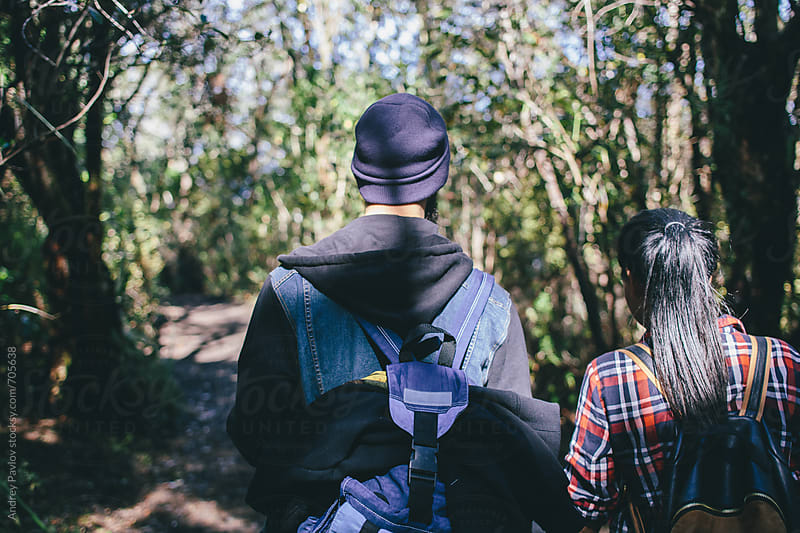 Coupe hiking with backpack in a forest by Andrey Pavlov for Stocksy United