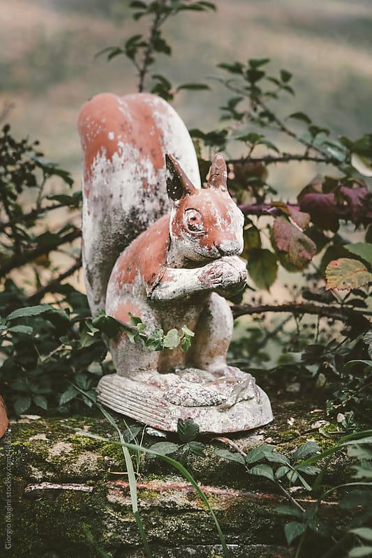 Ceramic Statue of a Squirrel in the Garden by Giorgio Magini for Stocksy United