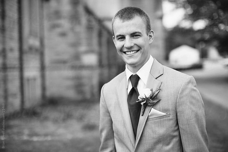 smiling groom by Brian Powell for Stocksy United
