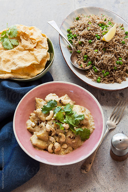 Indian curry dish creamy cashew chicken Murgh Shahi Korma by Nadine Greeff for Stocksy United