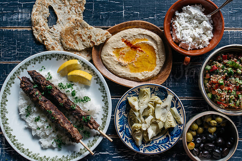 Traditional Middle Eastern lamb kefta dinner by Gabriel (Gabi) Bucataru for Stocksy United