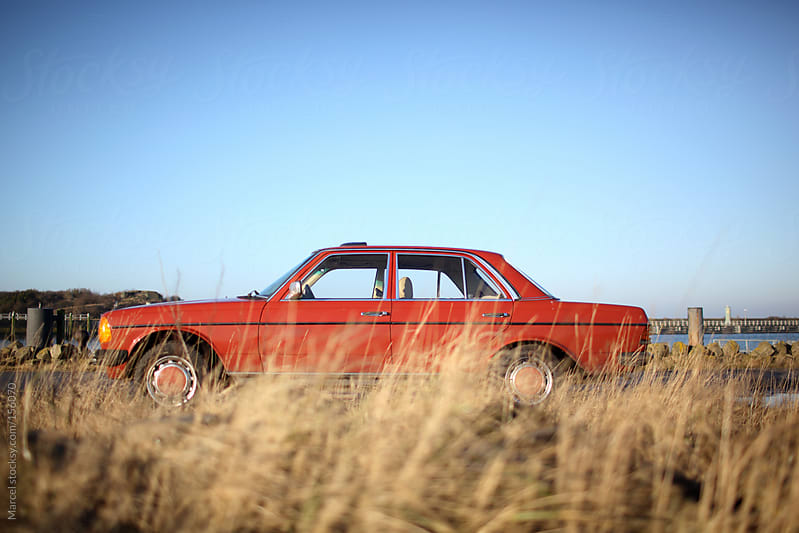 Vintage red car by Marcel for Stocksy United