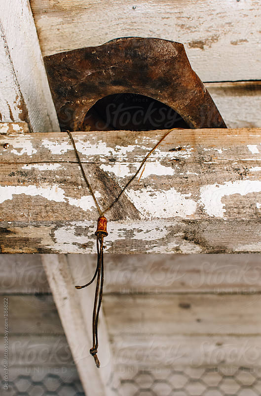 dusty leather hat in the rafters of a whitewashed shed by Deirdre Malfatto for Stocksy United