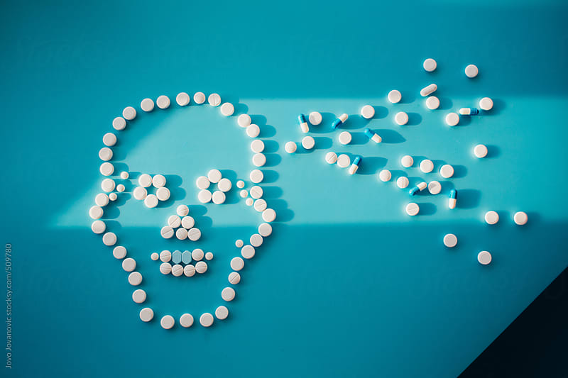 Skull made of white pills by Jovo Jovanovic for Stocksy United