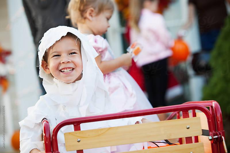 Halloween: Boy Riding In Wagon On Halloween by Sean Locke for Stocksy United
