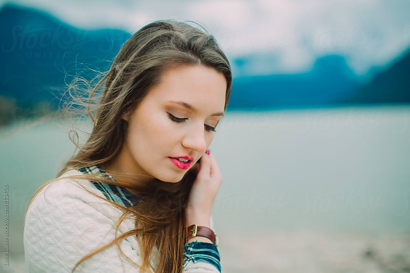 Young attractive girl embracing the cold wind by Luke Liable for Stocksy United