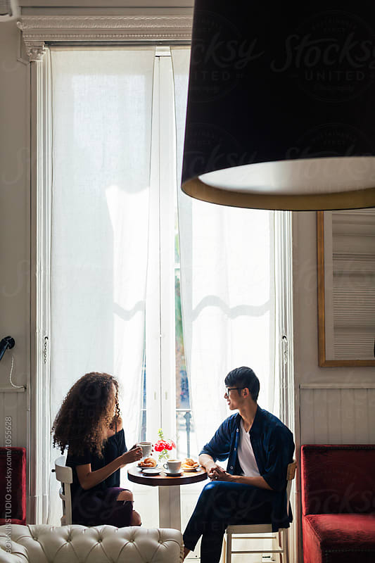 Trendy couple having breakfast in a coffee shop. by BONNINSTUDIO for Stocksy United