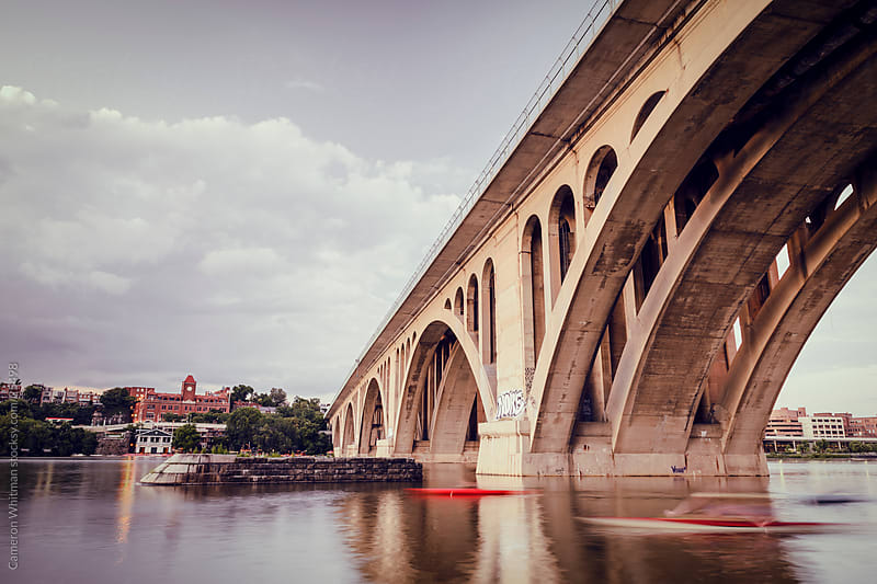 Key Bridge With Speeding Kayakers by Cameron Whitman for Stocksy United