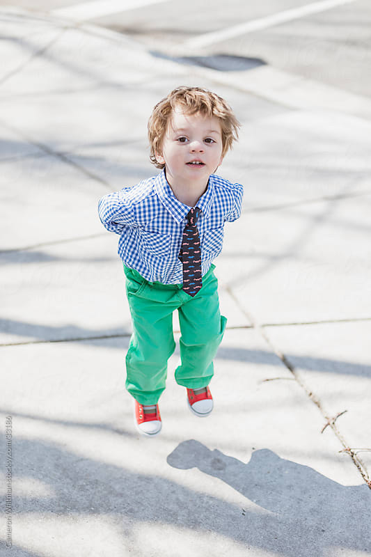 Dapper Little Boy Jumping  by Cameron Whitman for Stocksy United