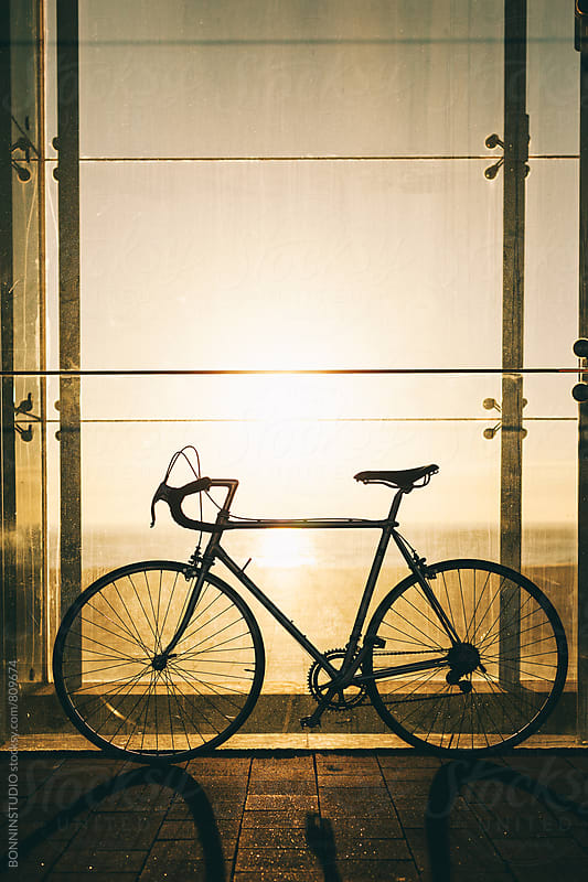 Vintage bicycle on sunrise. by BONNINSTUDIO for Stocksy United