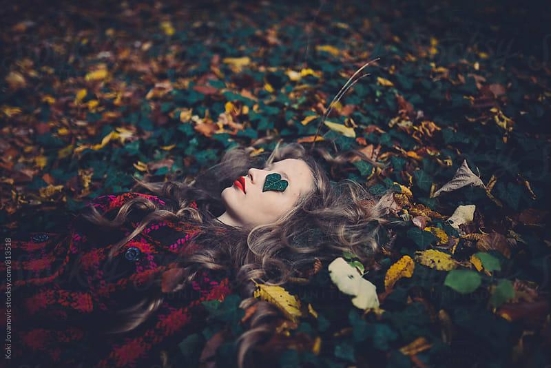 Young girl enjoying nature in autumn by Koki Jovanovic for Stocksy United