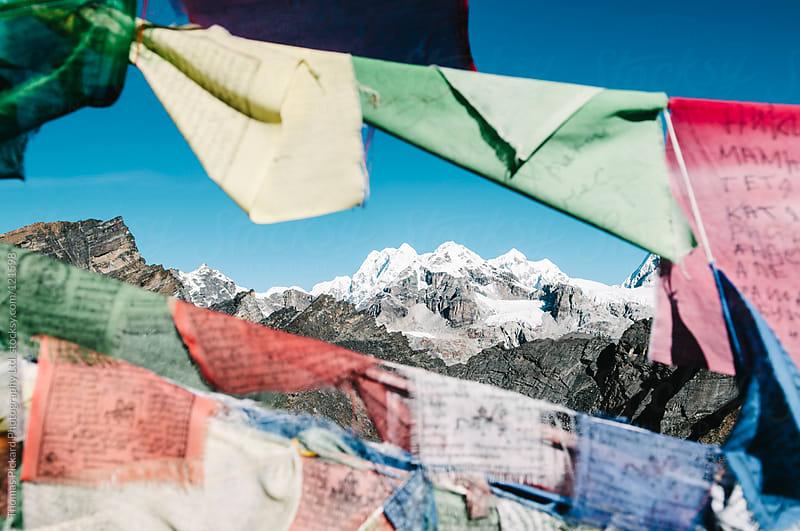 Mountains and prayer flags, Everest Region, Sagarmatha National Park, Nepal. by Thomas Pickard for Stocksy United