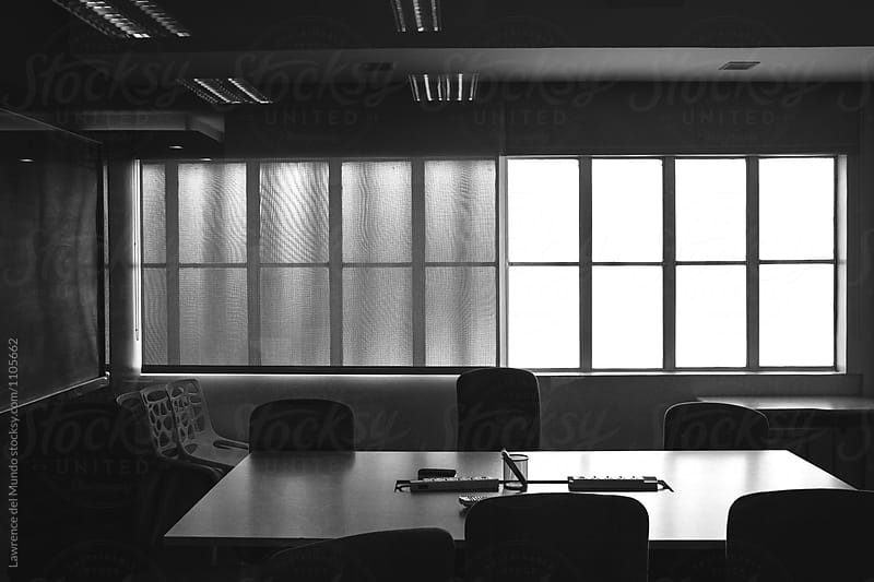 Black and white photo of an empty conference room in an office.