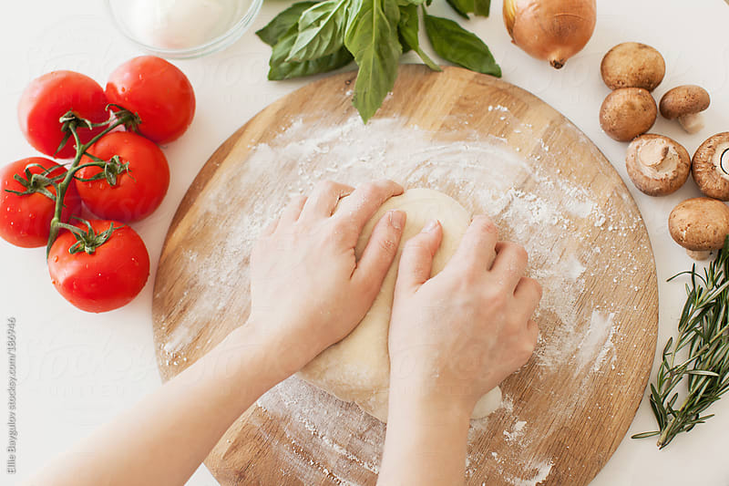 Pizza in process by Ellie Baygulov for Stocksy United