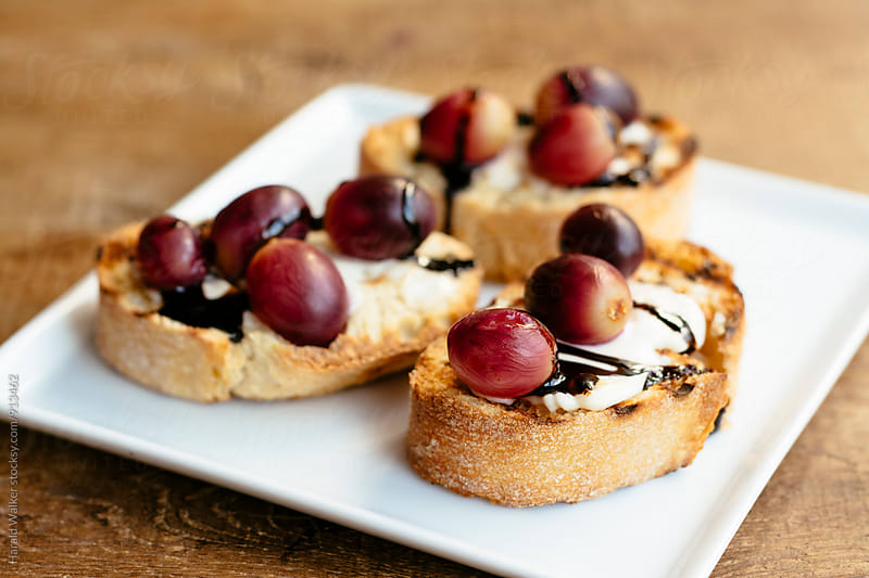 Roasted Grape Crostini by Harald Walker for Stocksy United