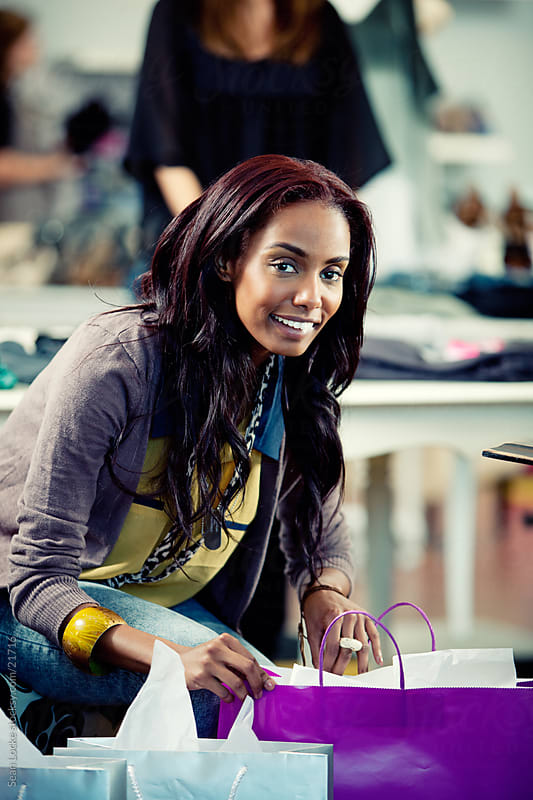 Boutique: Woman Taking a Break From Shopping by Sean Locke for Stocksy United