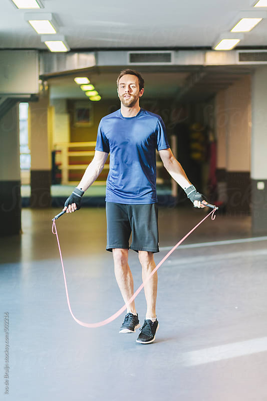 A boxer jumping rope as a training for boxing by Ivo de Bruijn for Stocksy United