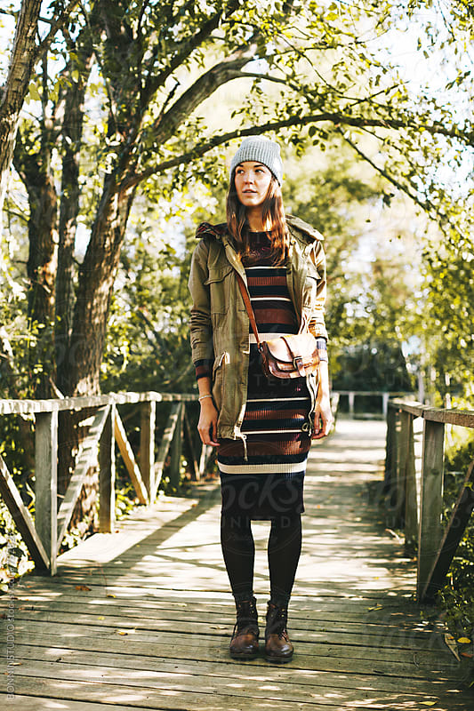 Young hipster woman standing in a wooden bridge in the forest. by BONNINSTUDIO for Stocksy United