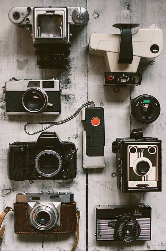 The Old Cameras on a White Board by Branislav Jovanovic for Stocksy United