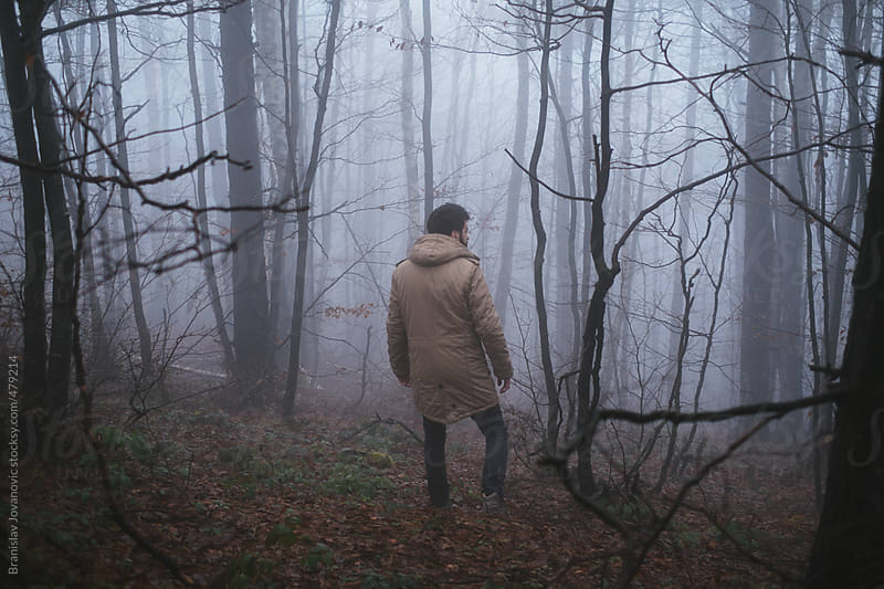 Back view of a man in the woods by Brkati Krokodil for Stocksy United