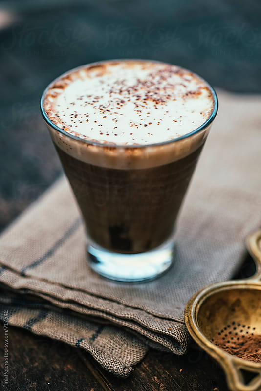 Food: Vegan iced coffee with soy milk and carob by Ina Peters for Stocksy United