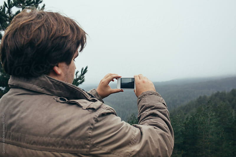 Man Photographing a Landscape With a Mobile Phone by Lumina for Stocksy United
