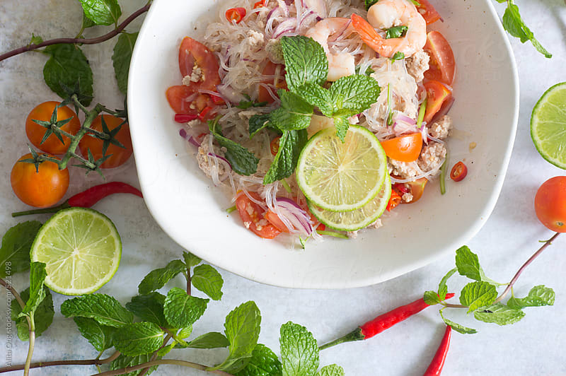 Freshly prepared Thai glass noodle salad by Alita Ong for Stocksy United