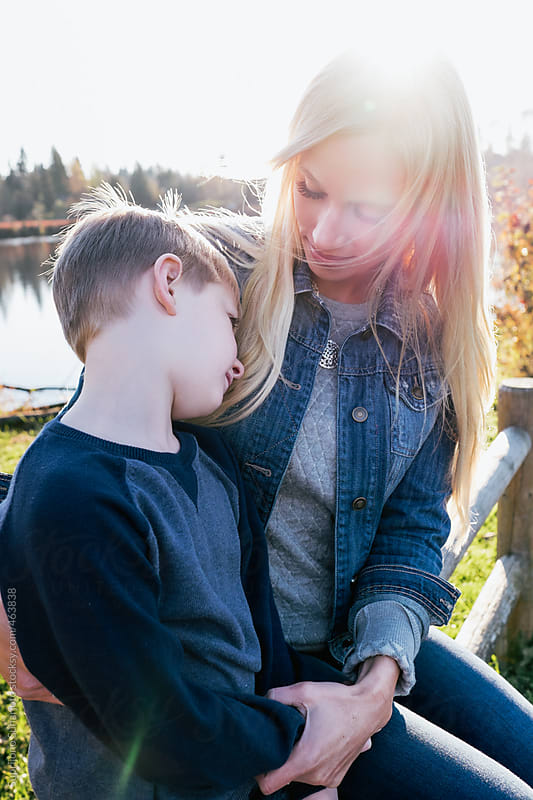 Mother and son outdoor on a sunny day by Suprijono Suharjoto for Stocksy United