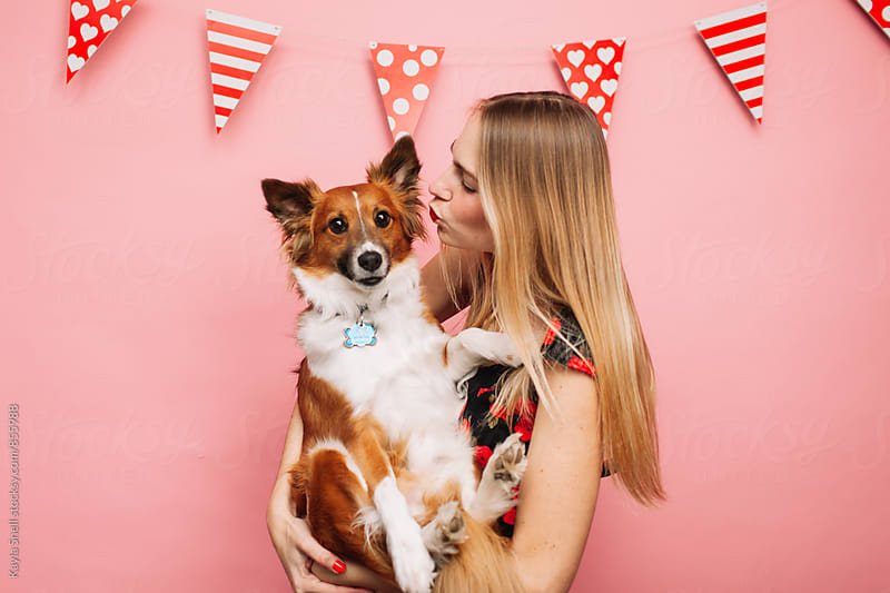 Woman on Valentine's day with her dog by Kayla Snell for Stocksy United