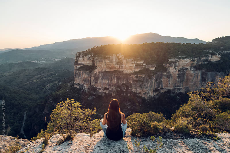 A woman enjoying the peaceful sunset in the nature by Jordi Rulló for Stocksy United