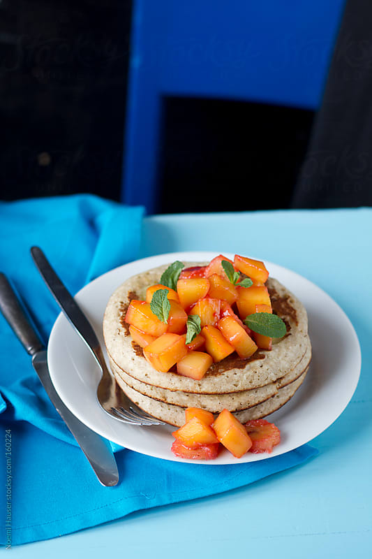 Pancakes topped with fruit by Noemi Hauser for Stocksy United