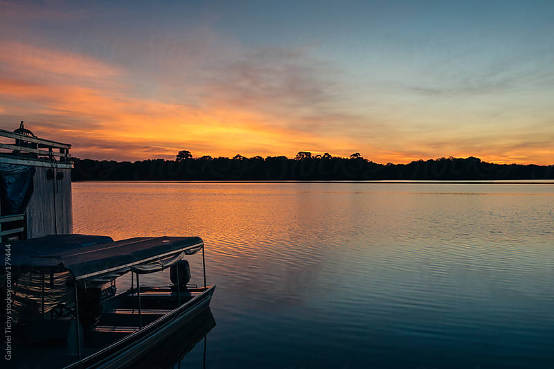 Boats in beautiful sunrise by Gabriel Tichy for Stocksy United