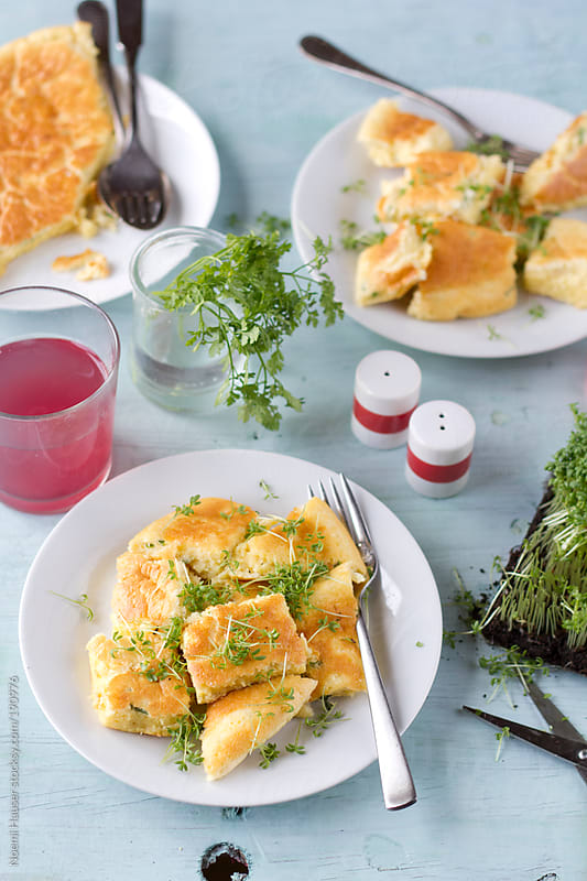 Shredded cheese pancake with cress by Noemi Hauser for Stocksy United