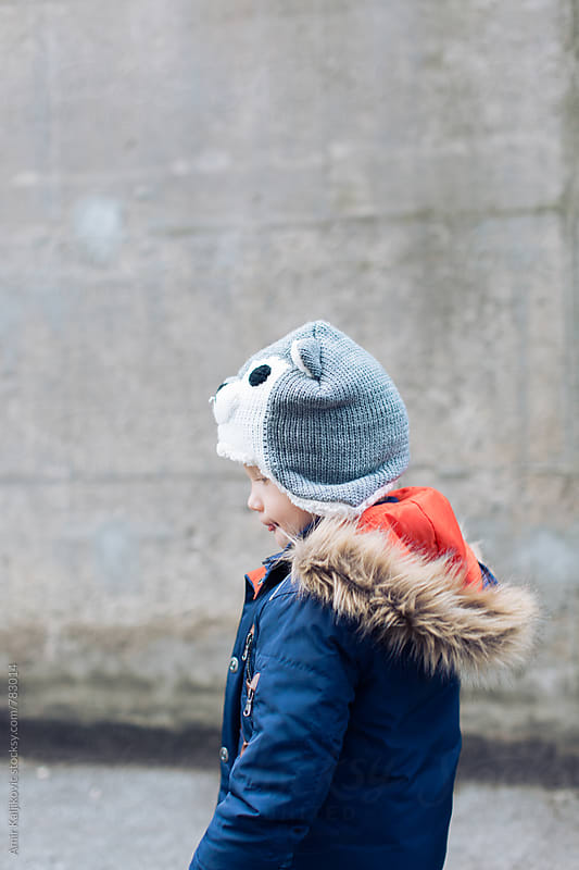 Little boy in autumn fashion by Amir Kaljikovic for Stocksy United