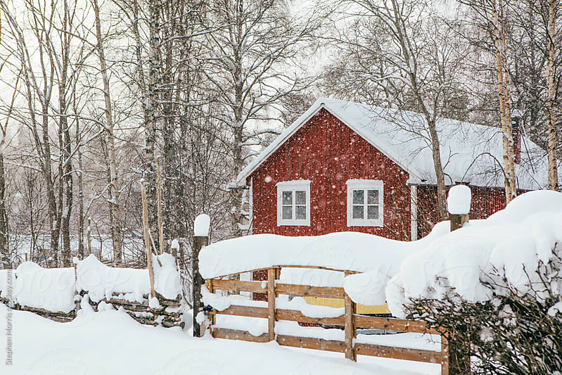 Red Cottage in Snowy Landscape by Stephen Morris for Stocksy United