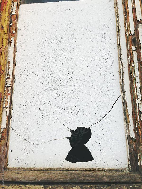 Boken window in man shaped by Jovana Rikalo for Stocksy United