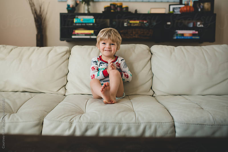 Little boy watches TV by Courtney Rust for Stocksy United