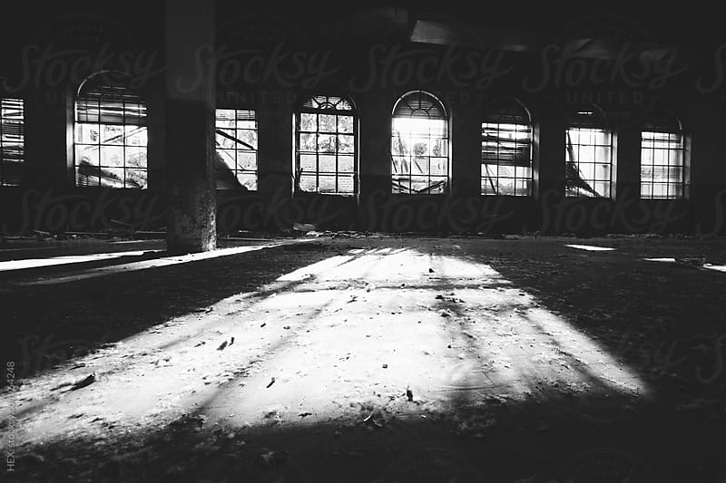Old abandoned Hall. Bw image by HEX . for Stocksy United