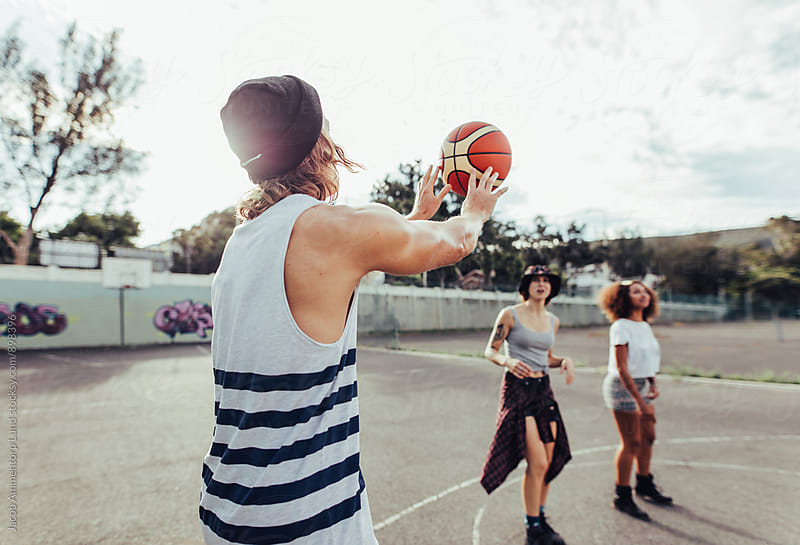 Group of friends playing basketball by Jacob Ammentorp Lund for Stocksy United