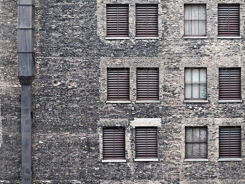 Facade of a stone building by Melanie Kintz for Stocksy United