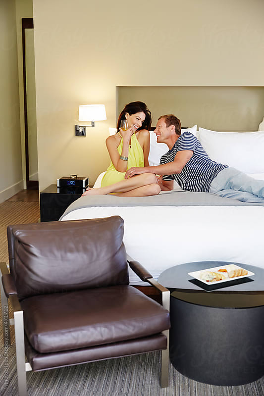Beautiful couple relaxing in luxury hotel room by Trinette Reed for Stocksy United