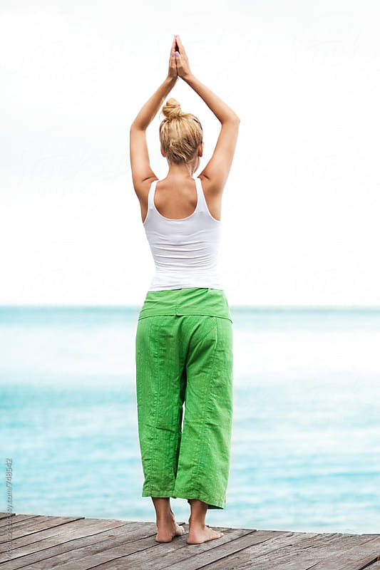 Woman Exercising Yoga by the Ocean by Mosuno for Stocksy United