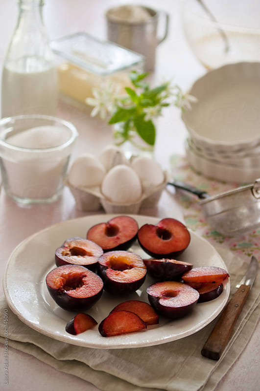 plums in a plate  by Laura Adani for Stocksy United