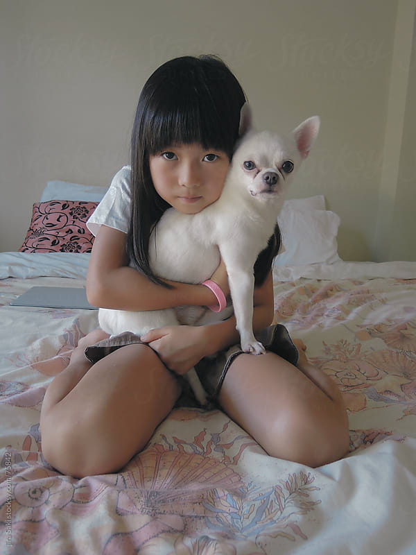 girl and dog by jira Saki for Stocksy United