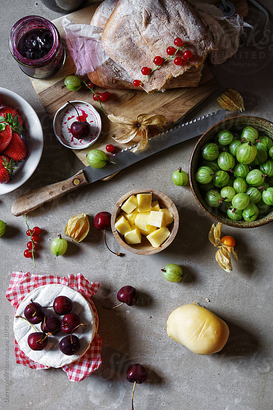 Fruit,bread,cheese and preserve nibbles. by Darren Muir for Stocksy United