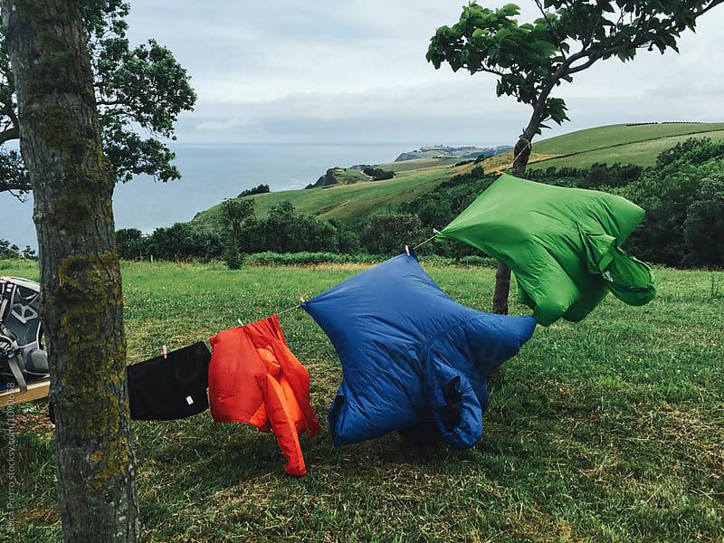 Colored raincoat on a clothesline while hiking the Camino de Santiago by Luca Pierro for Stocksy United