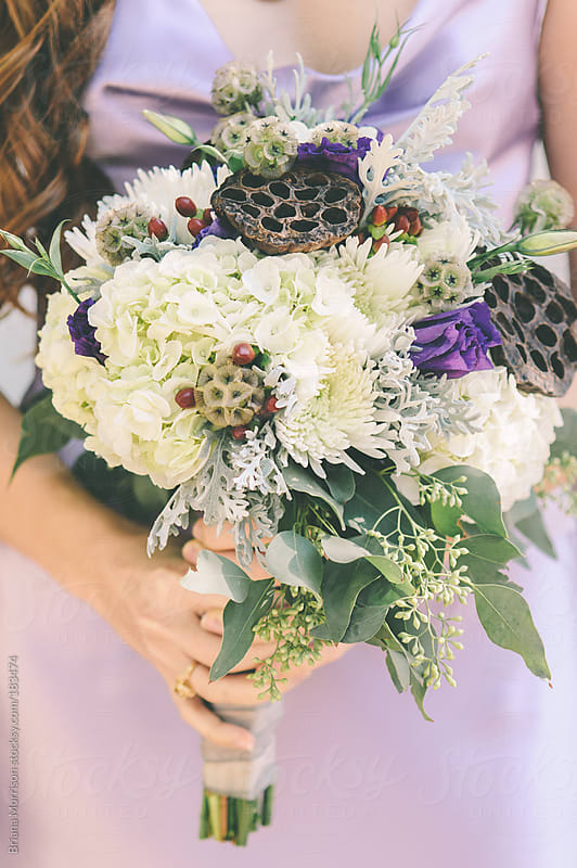 Woman in Purple Dress Holding White and Green Bouquet by Briana Morrison for Stocksy United