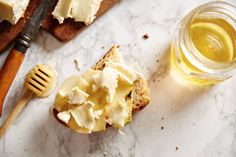 Camembert cheese with bread by Martí Sans for Stocksy United