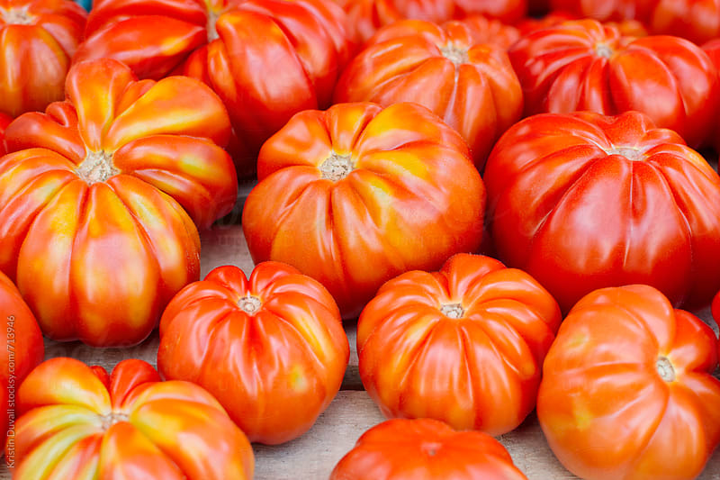 Organic Aurea heirloom tomatoes by Kristin Duvall for Stocksy United
