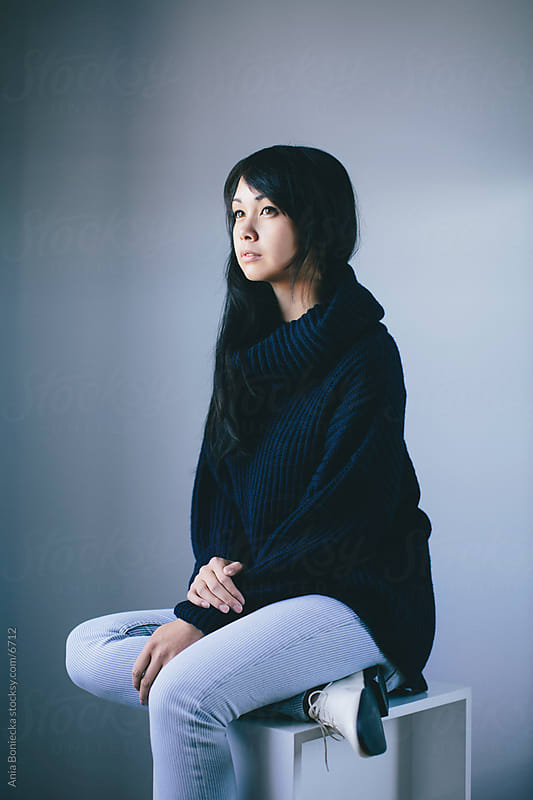 Portrait of a beautiful girl in a cozy sweater by Ania Boniecka for Stocksy United